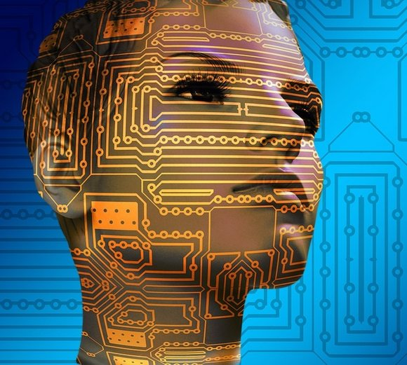 Digital face of a woman in front of circuits